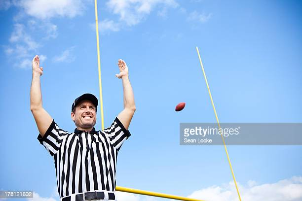 american football referee: signalling a touchdown - american football referee stock pictures, royalty-free photos & images