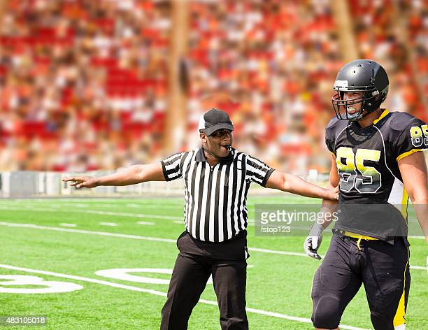 american football referee signals a play during the game. player. - american football referee stock pictures, royalty-free photos & images