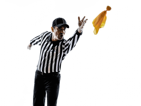 american football referee throwing yellow flag silhouette 499084155
