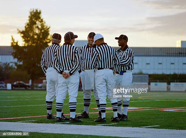 american football referees talking in field - american football referee stock pictures, royalty-free photos & images