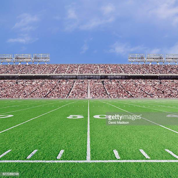 american football stadium with empty field and crowd - bleachers stock pictures, royalty-free photos & images