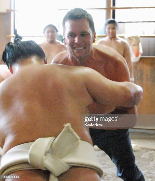 American football star Tom Brady takes part in a training session with ozeki Goeido at the Sakaigawa sumo stable in Tokyo on June 22 2017 Brady a...