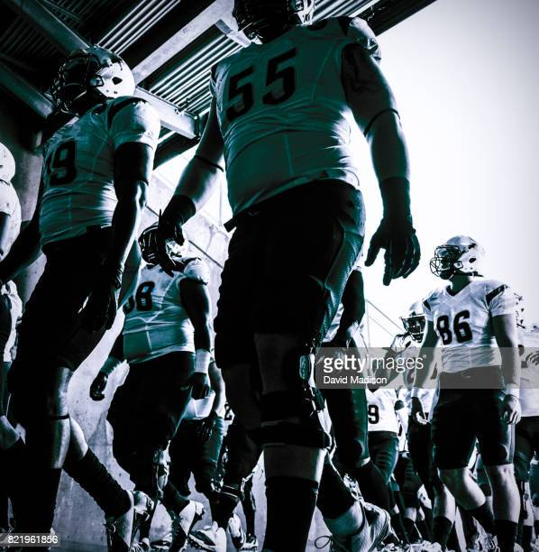 american football team enters football stadium - football americano foto e immagini stock