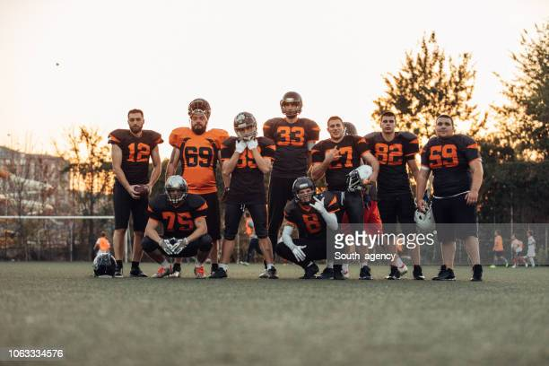 american football team on field - american football team stock pictures, royalty-free photos & images
