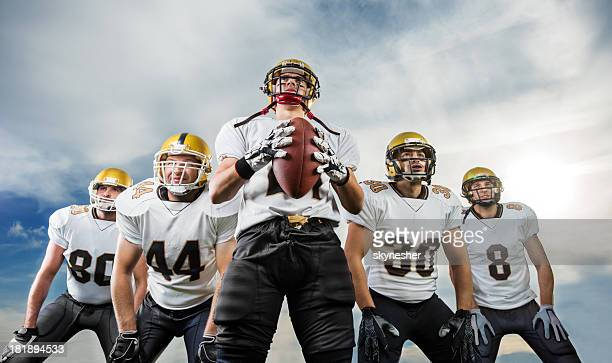 american football team. - quarterback stock photos and pictures