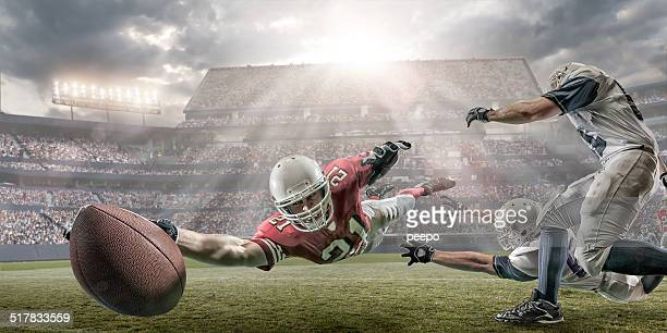 american football touchdown - amerikanischer football stock-fotos und bilder