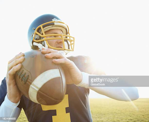 american footballer about to throw the ball - quarterback stock pictures, royalty-free photos & images