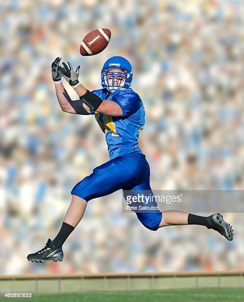 American footballer catching ball