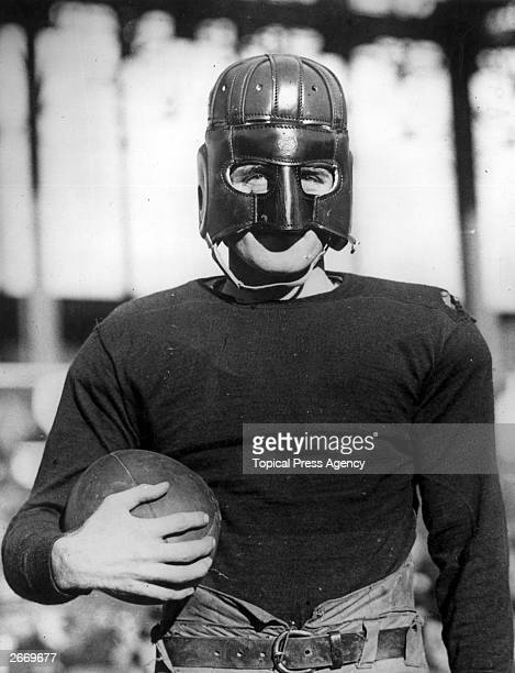 American footballer 'Hinkey' Haines of the New York Football Giants wearing the latest design of protective headgear for football players