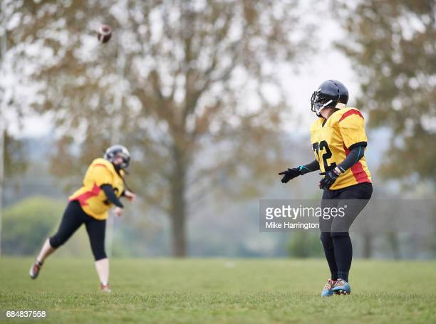 american footballer receiving ball - safety american football player stock pictures, royalty-free photos & images