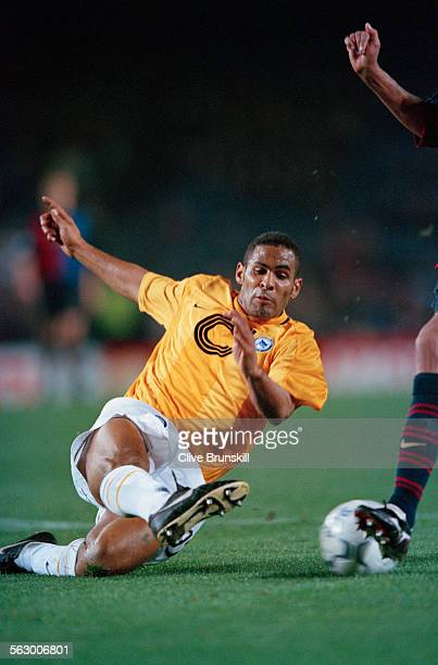 American footballer Tony Sanneh of Berlin team Hertha BSC makes a sliding tackle during a UEFA Champions League second group stage match against...