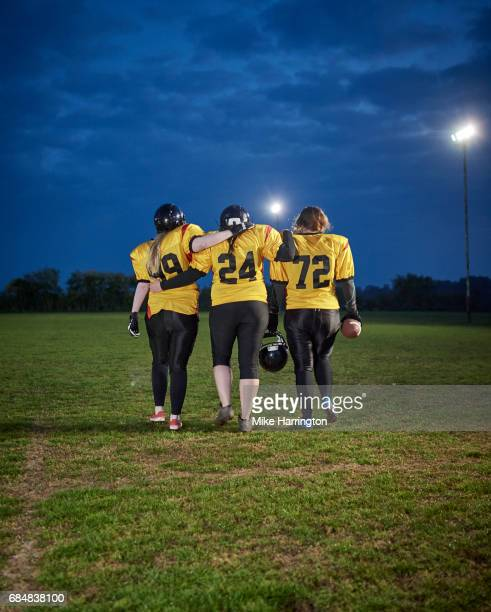 american footballers walking off pitch - safety american football player stock pictures, royalty-free photos & images