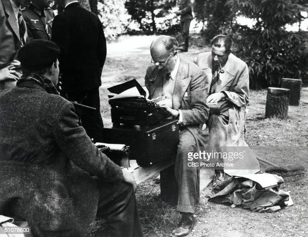American foreign correspondent William L Shirer with other reporters as they cover the German Blitzkrieg or 'Lightning War' in Compiegne France June...