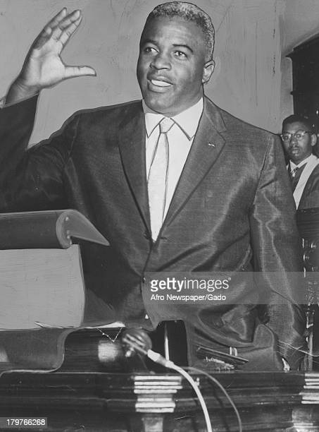 American former baseball player Jackie Robinson of the Brooklyn Dodgers giving a speech from Sharp St Memorial Methodist church pulpit about the...