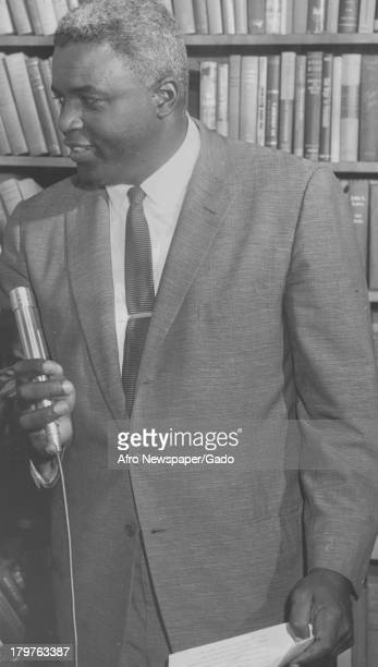 American former baseball player Jackie Robinson of the Brooklyn Dodgers prepares for his radio show interview with Marian Anderson Duncan New Jersey...