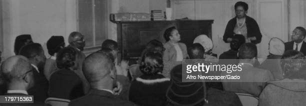 American former baseball player Jackie Robinson of the Brooklyn Dodgers is greeted by an enthusiastic crowd as he arrived at Zion Baptist Church to...