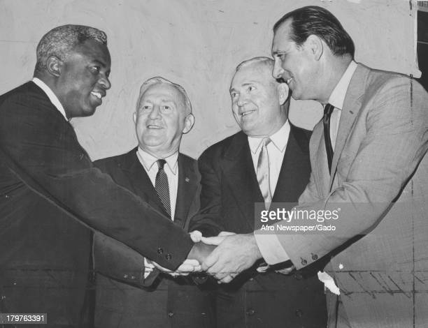 American former baseball player Jackie Robinson of the Brooklyn Dodgers is congratulated on his election to the Baseball Hall of Fame October 2 1962
