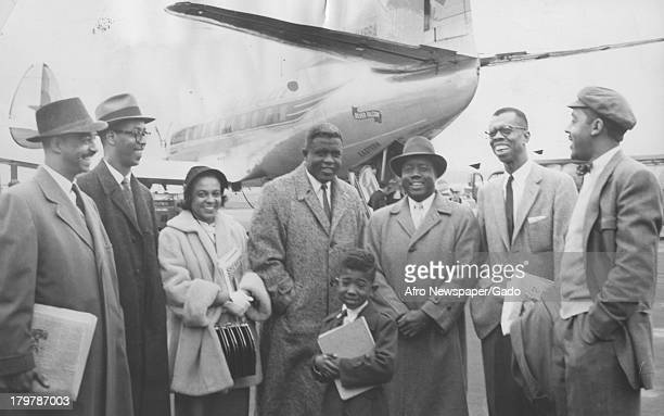 American former baseball player Jackie Robinson of the Brooklyn Dodgers is greeted at the airport as he arrived to speak at Southeastern Regional...