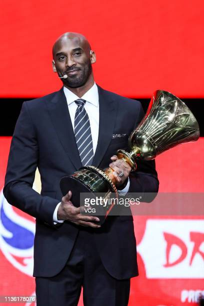 American former basketball player Kobe Bryant poses with trophy during FIBA Basketball World Cup 2019 Draw Ceremony at Shenzhen Bay Arena on March 16...