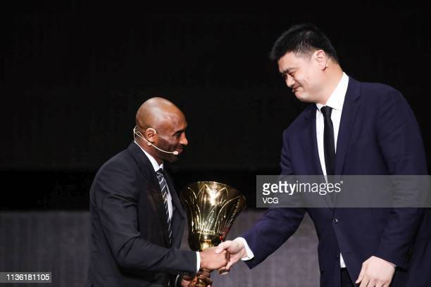 American former basketball player Kobe Bryant shakes hands with President of the Chinese Basketball Association Yao Ming during FIBA Basketball World...