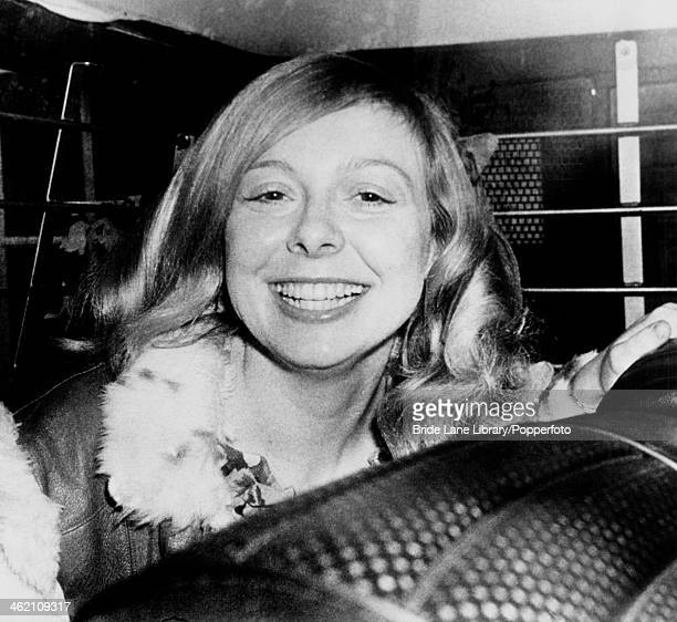 American former beauty queen Joyce McKinney in a police van on her way to a pretrial hearing at Epsom Magistrates' Court Surrey after being charged...
