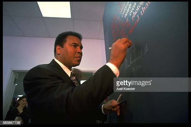 American former boxer Muhammad Ali presents the oral history Healing A Journal of Tolerance and Understanding a jiont project with American author...