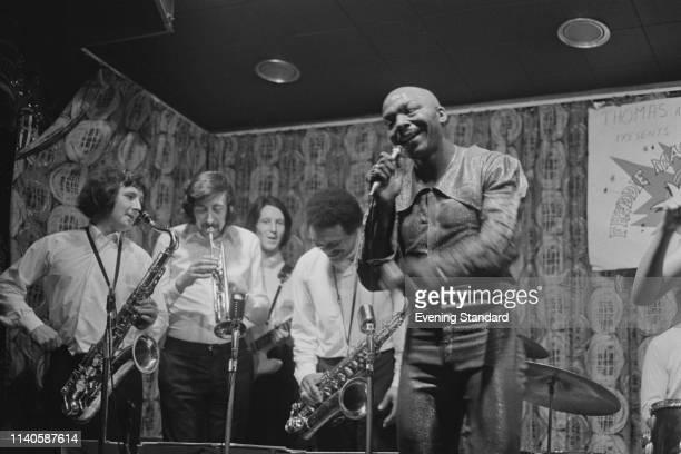 American former boxer singer and disc jockey Freddie Mack performing live with his band 'Freddie Mack Extravanganza' at Thomas A Beckett Old Kent...