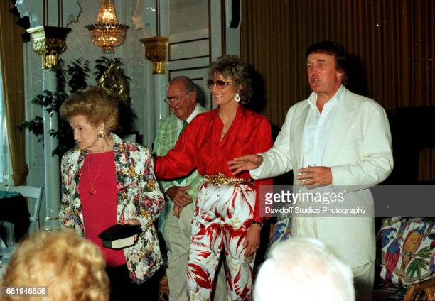 American former competative swimmer Marjorie Post Dye stands with Mary Trump and the latter's son, real estate developer Donald Trump, during an...