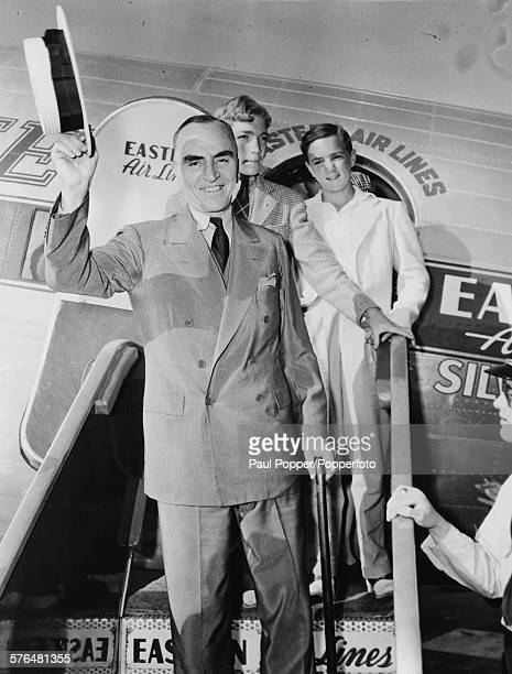 American former fighter ace and recipient of the Medal of Honor Eddie Rickenbacker smiles and doffs his hat as he arrives home on an Eastern Airlines...