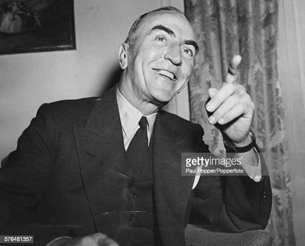 American former fighter ace Eddie Rickenbacker smiles as he tells reporters about his adventures in the Pacific and being lost at sea during World...
