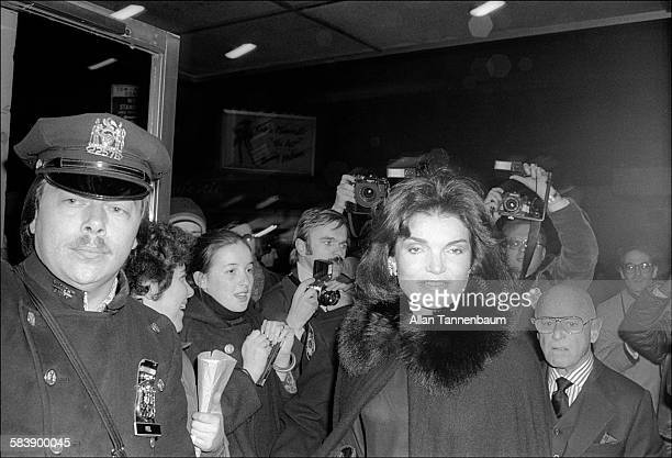 American former First Lady Jacqueline Kennedy Onassis arrives at the premiere of '20th Century' with Irving 'Swifty' Lazar New York New York February...