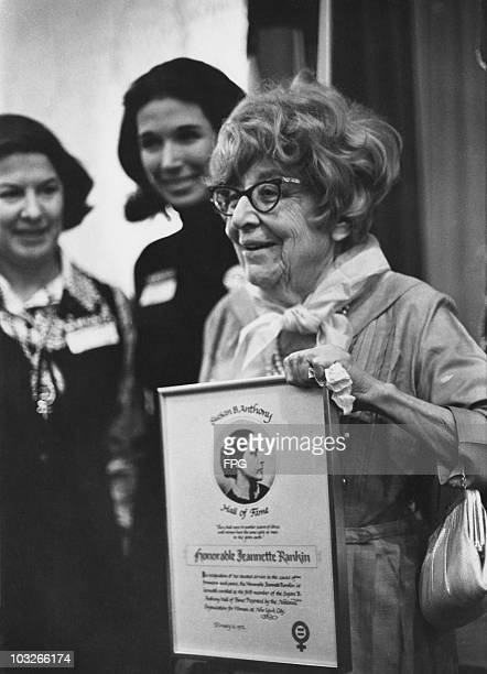 American former politician and peace activist Jeannette Rankin receives the first Susan B. Anthony Award at the Commodore Hotel, New York, 12th...