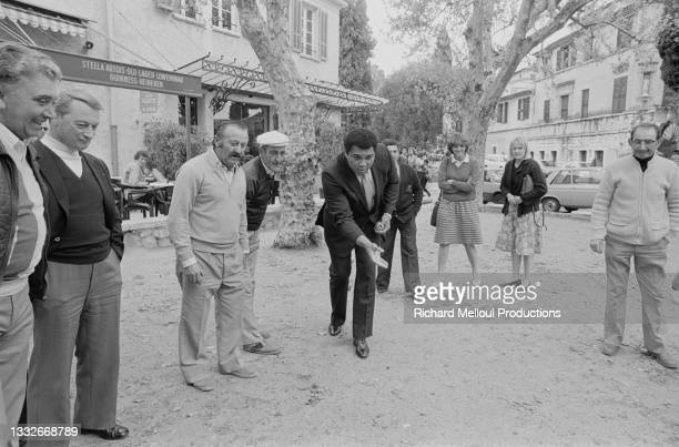 American former professional boxer and social activist Muhammad Ali, born Cassius Clay Jr., receives suggestions from the locals on how to play...