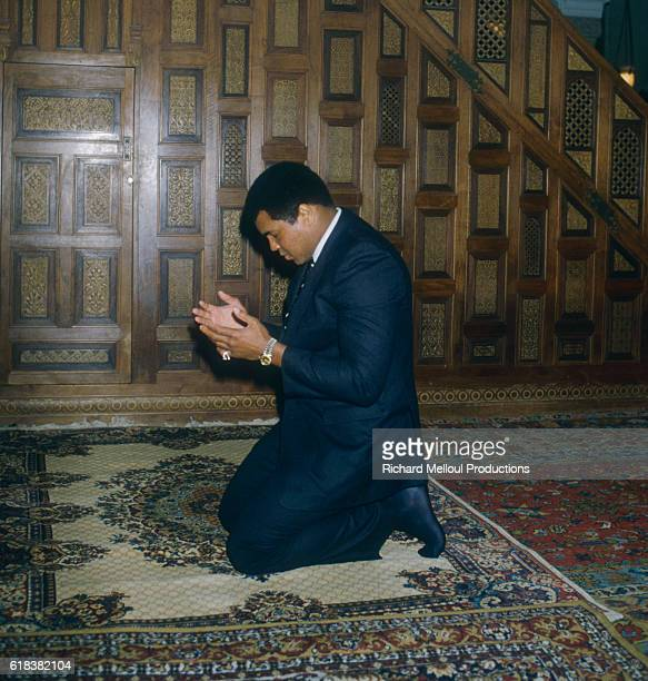 American former professional boxer and social activist Muhammad Ali born Cassius Clay Jr praying during a visit in Cannes