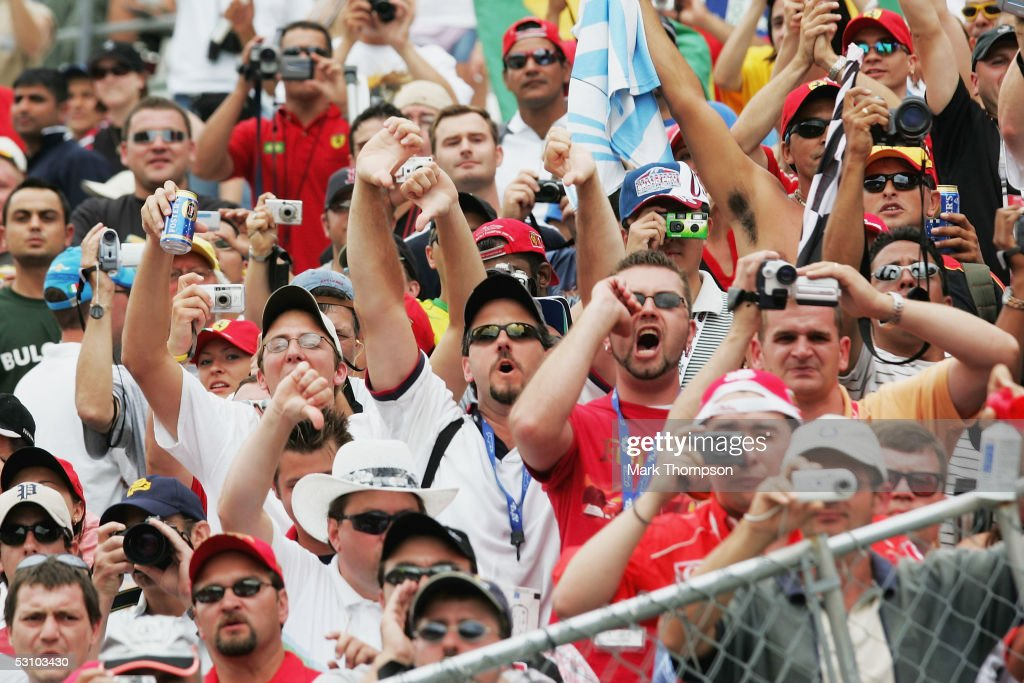 American Formula One fans display their displeasure during the podium presentation after all the teams with Michelin tyres retired after the warm up lap during the United States F1 Grand Prix at the Indianapolis Motor Speedway on June 19, 2005 in Indianapolis, Indiana.