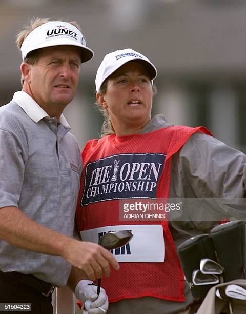 American Fred Funk and his caddie Fanny Sunesson look the fairway before teeing at SaintAndrews 20 July 2000 during the first round of the 2000...