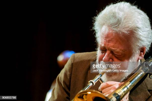 American Free Jazz musician Roswell Rudd plays trombone as he performs onstage during the 'Archie Shepp/Roswell Rudd Live in New York' concert at...