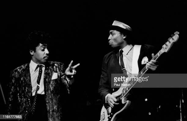 American Funk and Pop musicians Morris Day on vocals and Terry Lewis on bass guitar both of the Time as they perform onstage at the Auditorium...