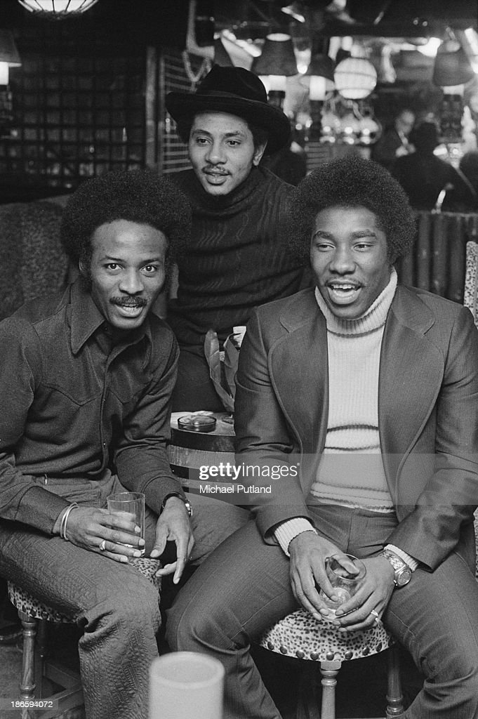American funk and soul group The O'Jays at a reception in London, December 1973. Left to right: Walter Williams, William Powell (1942 - 1977) and Eddie Levert.