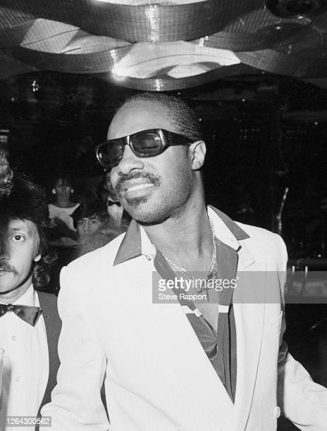 American Funk, Pop, and R&B musician Stevie Wonder attends a party, Kensington High Street, London, 6/28/1984.