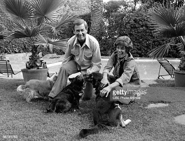 American game show host Bob Barker and his wife Dorothy Jo play with three dogs in their back yard November 4 1977
