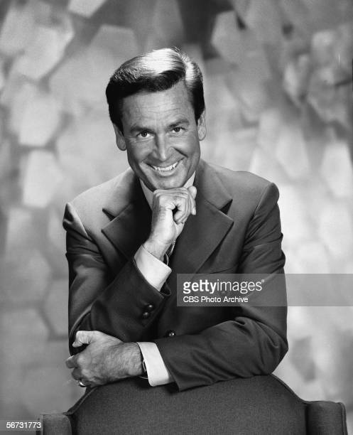 American game show host Bob Barker leans against a chair and poses with his chin on his hand in a publicity still for the Miss Universe Beauty...