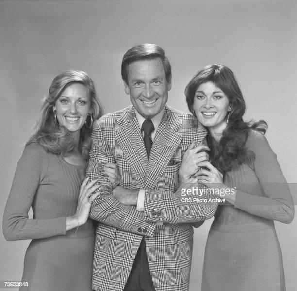 American game show host Bob Barker poses flanked by two of the socalled 'Barker's Beauties' models Janice Pennington and Anitra Ford for the CBS game...