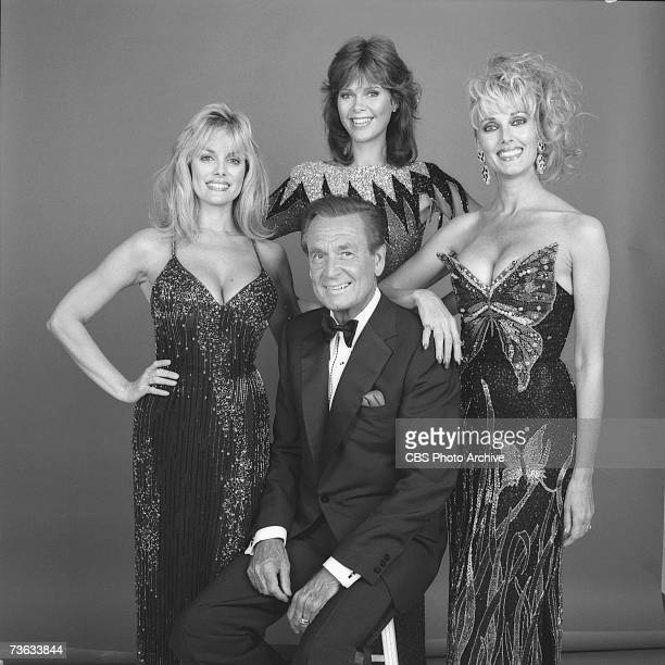 American game show host Bob Barker sits as he poses with three of the socalled 'Barker's Beauties' models Dian Parkinson Holly Halstrom and Janice...