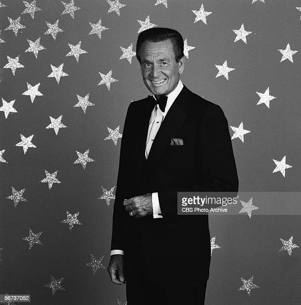 American game show host Bob Barker stands in black tie before a backdrop emblazoned with stars in a publicity photo July 1 1986