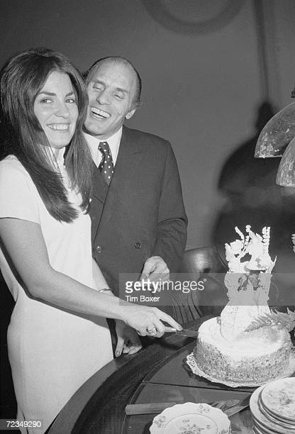 American gangster Joe Gallo also known as Crazy Joey smiles as his wife Sina Essary cuts the cake at their wedding reception New York New York mid...