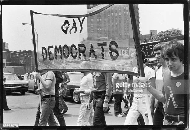 American gay rights activists Jim Owles and Allen Roskoff carry a banner that reads 'Gay Democrats in the Fifth Annual Gay Pride Day march New York...