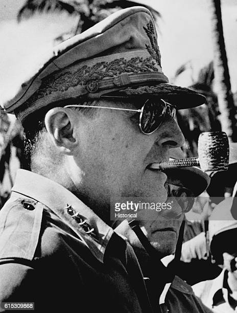 American general Douglas MacArthur with his characteristic corncob pipe and sunglasses ca 1945 MacArthur served as Allied supreme commander in the SW...