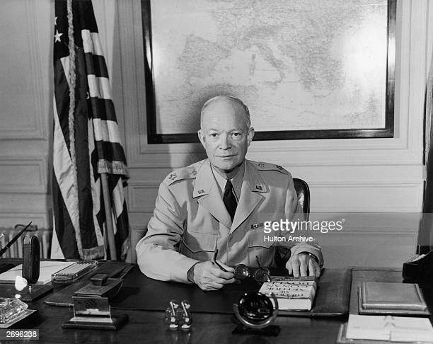 American General Dwight D Eisenhower , Supreme Allied Commander at his desk in the Marly headquarters. A Republican politician, he later became the...