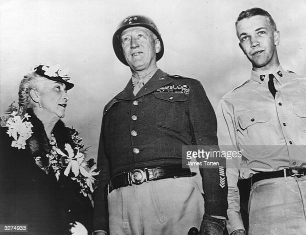 American General George S Patton Jr 'Old Blood & Guts' Commander of US 3rd Army, with his wife Beatrice, and son George Patton IV , a West Point...